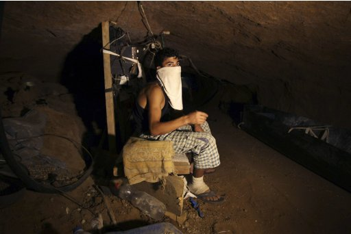 A Palestinian smuggler rests inside a tunnel beneath the Egyptian-Gaza border in Rafah