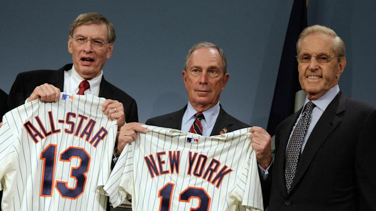Major League Baseball Commissioner Bud Selig, left, and New York Mayor Michael Bloomberg, center, and New York Mets owner Fred Wilpon, hold Mets shirts during a news conference at New York's City Hall, Wednesday, May 16, 2012, as it was announced that the 2013 All-Star baseball game will be hosted by the Mets at Citi Field. The Mets last hosted the All-Stars in 1964, the year Shea Stadium opened. (AP Photo/Richard Drew)
