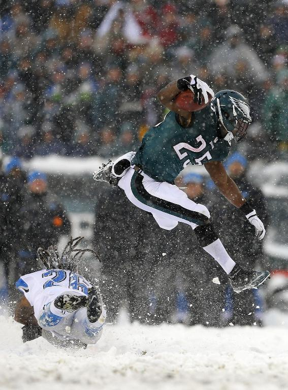 Running back LeSean McCoy (R) of the Philadelphia Eagles and Louis Delmas of the Detroit Lions, seen in action in the third quarter during their game at Lincoln Financial Field in Philadelphia, Pennsylvania, on December 8, 2013