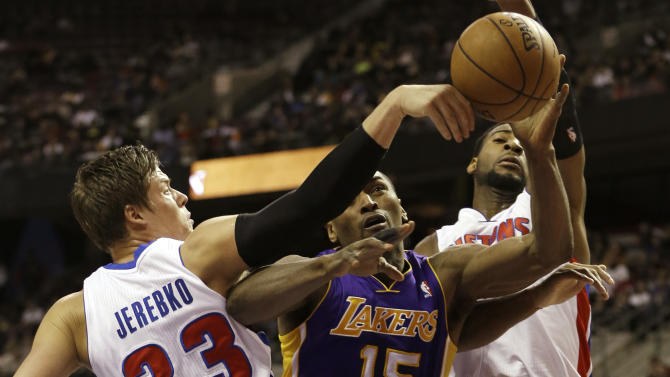 Detroit Pistons forward Jonas Jerebko (33) of Sweden knocks the ball away from Los Angeles Lakers forward Metta World Peace (15) during the first quarter of an NBA basketball game at the Palace of Auburn Hills, Mich., Sunday, Feb. 3, 2013. (AP Photo/Carlos Osorio)