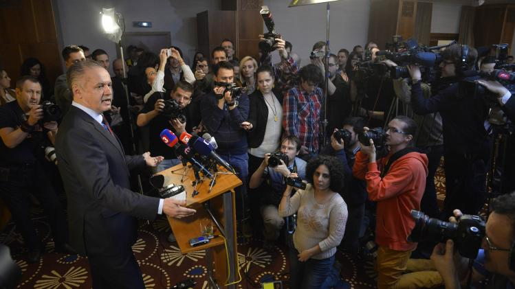 Candidate for the presidential election Andrej Kiska addresses journalists after the unofficial results at a party election centre in Bratislava