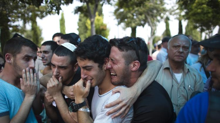 Friends and relatives of Israeli soldier Tal Yifrah mourn during his funeral near Tel Aviv