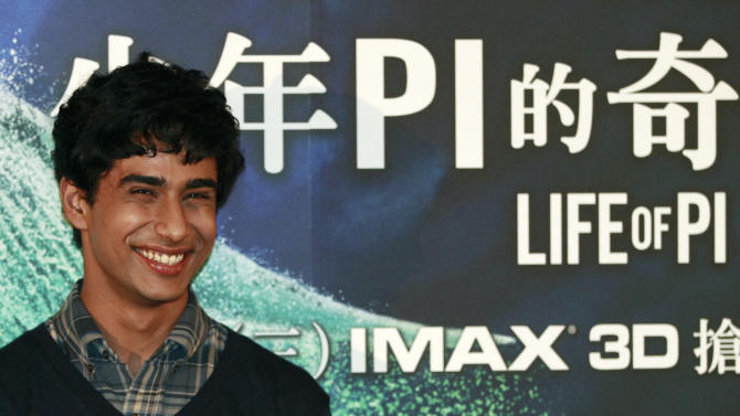 "Lead actor from India Suraj Sharma poses for media during a press conference announcing his new film ""Life of Pi,"" in Taipei, Taiwan, Wednesday, Nov. 7, 2012. ""Life of Pi"" is an upcoming 3D adventure film based on the 2001 novel of the same name by Yann Martel, staring Sharma and directed by veteran director Ang Lee. (AP Photo/Wally Santana)"