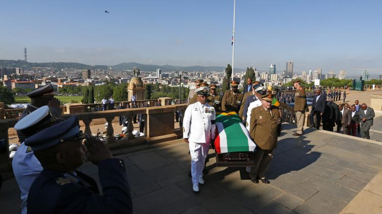 The body of former South African President Nelson Mandela arrives at the Union Buildings in Pretoria