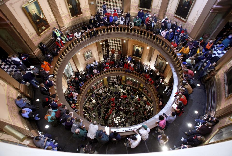 Protesters gather in the Michigan Capitol Rotunda as they rally against Gov. Rick Snyder's proposals to tax pensions and give emergency financial managers sweeping new powers to void union contracts Wednesday, March 16, 2011, in Lansing, Mich. (AP Photo/Al Goldis)