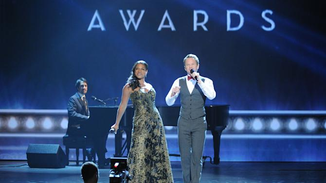 Audra McDonald, left, and Neil Patrick Harris, right, perform the finale of the 67th Annual Tony Awards, on Sunday, June 9, 2013 in New York. (Photo by Evan Agostini/Invision/AP)