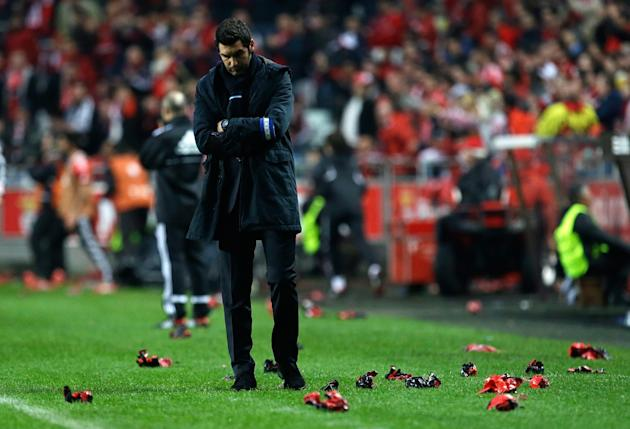 Porto's coach Paulo Fonseca walks on the sideline during their Portuguese league soccer match with Benfica Sunday, Jan. 12 2014, at Benfica's Luz stadium in Lisbon. Benfica defeated Porto 2-0