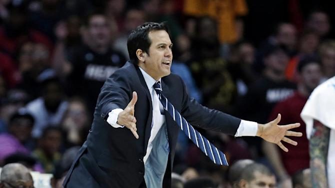 Miami Heat head coach Erik Spoelstra reacts during the fourth quarter of an NBA basketball game against the Cleveland Cavaliers Wednesday, March 20, 2013, in Cleveland. Miami won 98-95. (AP Photo/Tony Dejak)
