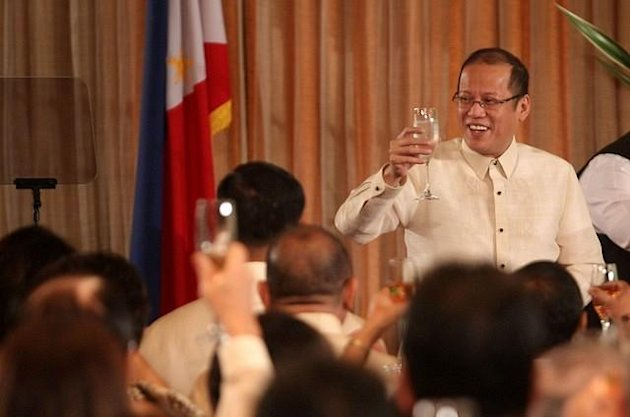 President Benigno S. Aquino III leads the traditional toast for the New Years Vin d Honneur at the Rizal Hall, Malacaan Palace on Friday (January 11, 2013). The annual reception, marks the 26th Vin d Honneur since the 1986 EDSA Revolution, is attended by government officials, members of the Diplomatic Corps, officials of international organizations and businessmen. (Photo by: Lauro Montellano, Jr./MPB/NPPA Images)