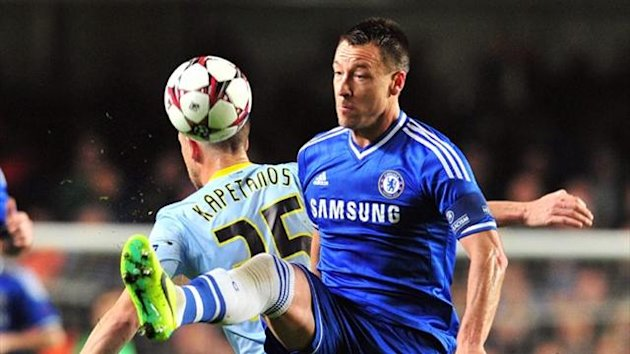 Chelsea defender John Terry vies with Steaua Bucharest's Italian striker Federico Piovaccari (AFP)