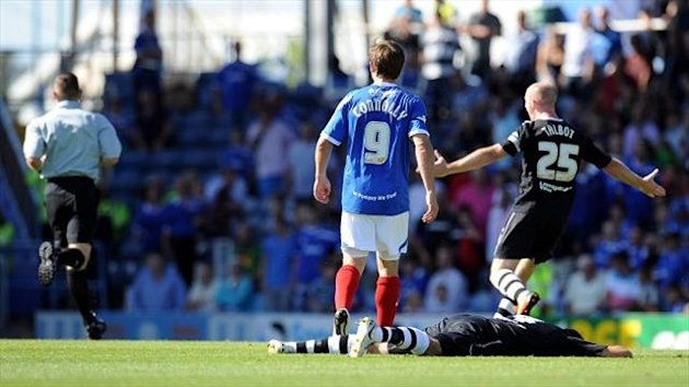 Portsmouth's David Connolly, left, was shown red against Chesterfield