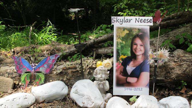 FILE - This Monday June 24, 2013 file photo shows a memorial that the family of 16-year-old Skylar Neese, of Star City, W.Va., has erected at a remote spot in Wayne Township, Pa., where the girl was allegedly stabbed to death last summer by two girls she believed were her best friends. (AP Photo/Vicki Smith, Pool)