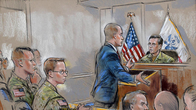 In this courtroom sketch, Army Pfc. Bradley Manning, second from left, sits as his attorney, David E. Coombs, speaks during a military hearing in Fort Meade, Md., Friday, Dec. 16, 2011, that will determine if Manning should face court-martial for his alleged role in the WikiLeaks classified leaks case. Manning is suspected of being the source in one of the largest unauthorized disclosures of classified information in U.S. history. (AP Photo/William Hennessy)