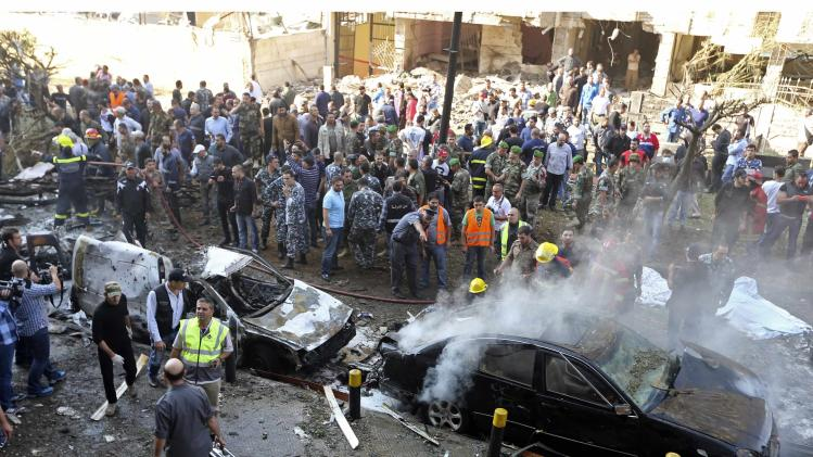 Soldiers, policemen and medical personnel gather at the site of explosions near the Iranian embassy in Beirut