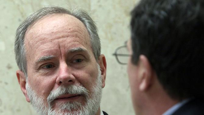 In this March 7, 2012 photo, David Coppedge, left, is shown outside Los Angeles Superior Court with his attorney, William Becker. Coppedge, a mission specialist who claims he was demoted - and then let go - by Jet Propulsion Laboratory for his workplace comments promoting his views on intelligent design, the belief that a higher power must have had a hand in creation because life is too complex to have developed through evolution alone. His lawsuit alleging improper dismissal against NASA begins Monday, March 12 in Los Angeles. (AP Photo/Nick Ut)