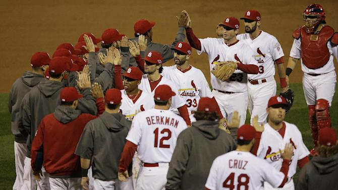 St. Louis Cardinals celebrate after beating the San Francisco Giants 3-1 in Game 3 of baseball's National League championship series Wednesday, Oct. 17, 2012, in St. Louis. St. Louis won 3-1. (AP Photo/Patrick Semansky)