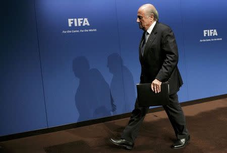 FIFA President Blatter leaves after a news conference at the FIFA headquarters in Zurich