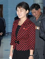 File photo of Ri Sol-Ju, North Korean leader Kim Jong-Un's wife. The attractive and stylish young woman contrasts sharply with her husband, clad in his customary Mao-style dark suit, and with the army officers in olive drab uniforms and oversized peaked caps
