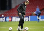 Nordsjaelland coach Kasper Hjulmand plays with the ball during a training sesion on the eve of the UEFA Champions League Group E football match against Chelsea in Copenhagen