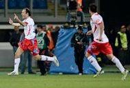 Catania defender Giovanni Marchese (L) celebrates after scoring against AS Roma during an Italian Serie A football match at Rome&#39;s Olympic stadium. Roma all but crashed out of European contention with a limp performance in a 2-2 draw at home to Catania