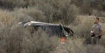 This video frame provided by KABC TV Los Angeles shows a California Highway Patrol officer during an investigation of a crash of an SUV in Action, Calif. on Sunday, March 24, 2013. A 9-year-old girl crawled out of the mangled SUV, climbed out of a canyon and walked about a mile in the middle of the night to find help after surviving the highway crash that killed her father in Southern California, authorities said. (AP Photo/KABC TV)