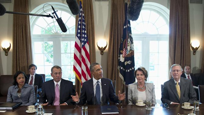 President Barack Obama speaks to media in the Cabinet Room of the White House in Washington, Tuesday, Sept. 3, 2013, before a meeting with Congressional leaders to discuss the situation in Syria. From left are, National Security Adviser Susan Rice, House Speaker John Boehner of Ohio, the president, House Minority Leader Nancy Pelosi of Calif., and Senate Minority Leader Mitch McConnell of Ky. (AP Photo/Carolyn Kaster)