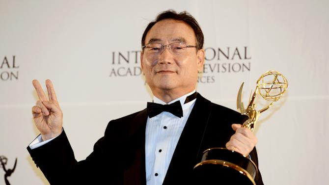 Dr. Kim In-Kyu, the president and CEO of the Korean Broadcasting System, poses after winning the Directorate Award at the 40th International Emmy Awards,  Monday, Nov. 19, 2012 in New York.  (AP Photo/Henny Ray Abrams)