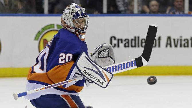 New York Islanders goalie Evgeni Nabokov (20), of Russia, deflects the puck in the third period of Game 4 of their first-round NHL hockey Stanley Cup playoffs hockey series against the Pittsburgh Penguins at Nassau Coliseum in Uniondale, N.Y., Tuesday, May 7, 2013. The Islanders won 6-4. (AP Photo/Kathy Willens)