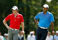 Rory McIlroy of Northern Ireland and Tiger Woods wait on the fourth green during the first round of the BMW Championship at Crooked Stick Golf Club on September 6, 2012 in Carmel, Indiana. McIlroy, who is fresh off a win last week at the Deutsche Bank Championship, fired an eight-under 64 to grab a share of the lead