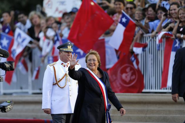 Chile's new president Michelle Bachelet greets to the crowd as she arrives at the La Moneda presidential palace after being sworn into office, in Santiago