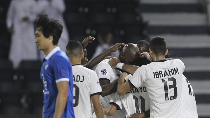 Qatar's Al-Sadd players celebrate after scoring a goal against Saudi Arabia's Al Hilal  during their AFC Champions League soccer match in Doha