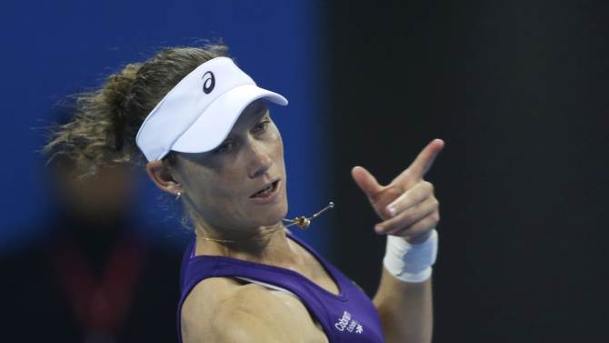 Samantha Stosur of Australia returns the ball during her women's singles tennis match at the China Open tennis tournament in Beijing