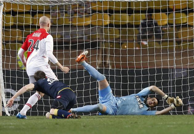 Sochaux's Butin scores aginst AS Monaco's Subasic during their French Ligue 1 soccer match in Monaco