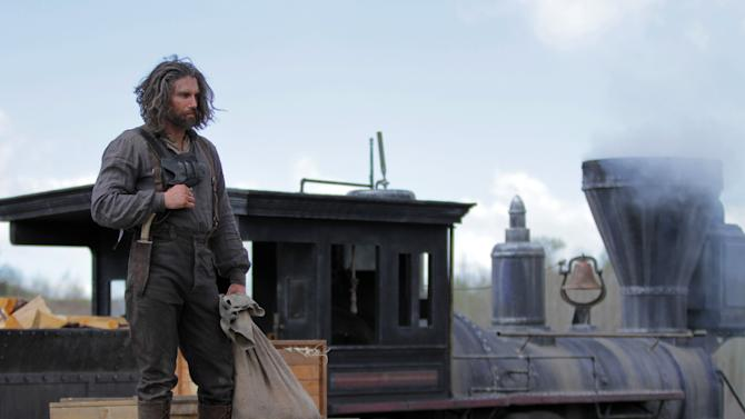 """This image released by AMC shows Anson Mount as Cullen Bohannon in a scene from """"Hell On Wheels,"""" airing Sundays at 9 p.m. EST on AMC. Returning for its second season, AMC's """"Hell on Wheels"""" focuses on Cullen Bohannon, a former Confederate soldier who after the war heads west to Nebraska to work on the transcontinental railroad and, he hopes, avenge the death of his wife at the hands of someone likely to be found at the Union Pacific construction camp. (AP Photo/AMC, Michelle Faye)"""