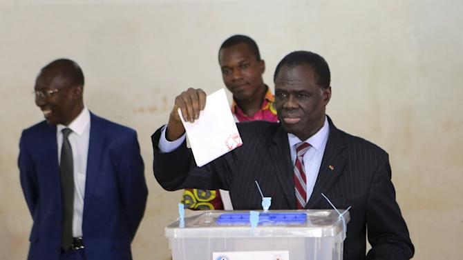 Kafando votes at a polling station during the presidential and legislative election in Ouagadougou
