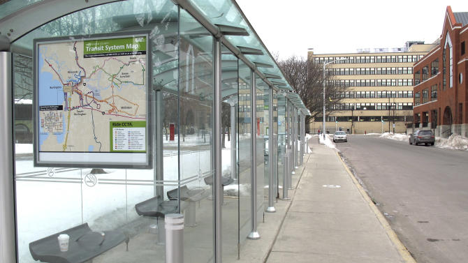 A bus stop in Burlington, Vt., remained unused Wednesday, March 26, 2014, as a strike by the city's bus drivers continued into a second week, leaving thousands of people scrambling to find ways to get to work, school and appointments. (AP Photo/Wilson Ring)