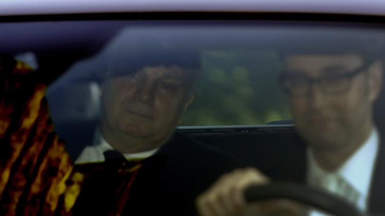 Bayern Munich President Hoeness arrives by car for his trial for tax evasion at a regional court in Munich