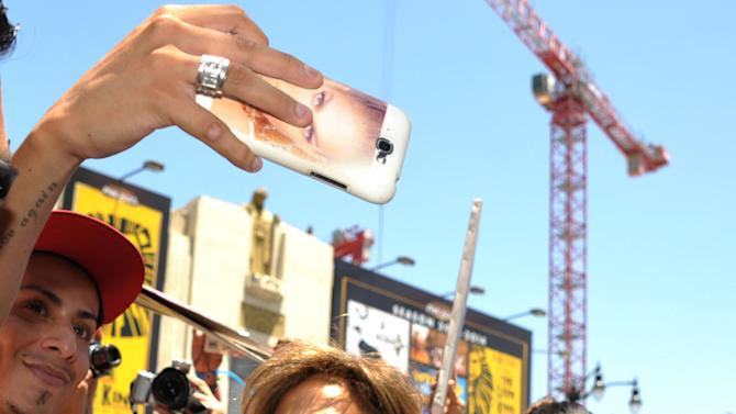 Jennifer Lopez greets fans at a ceremony honoring her with a star on the Hollywood Walk of Fame on Thursday, June 20, 2013 in Los Angeles. (Photo by John Shearer/Invision/AP)