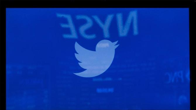 A screen displays the Twitter logo ahead of the company's IPO on the floor of the New York Stock Exchange