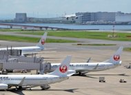 Japan Airlines marked a spectacular return from bankruptcy when its shares soared in early trade after relisting in Tokyo, three years after it became one of the nation&#39;s worst ever failures