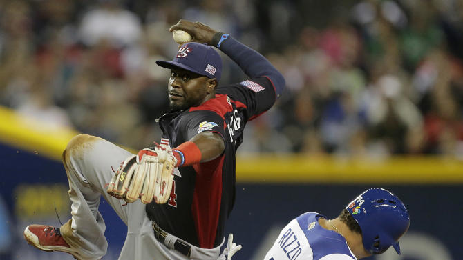 United States second baseman Brandon Phillips gets tangled up with Italy's Anthony Rizzo after Rizzo was out at second on a force out hit into by Alex Liddi in the first inning of a World Baseball Classic game Saturday, March 9, 2013, in Phoenix. (AP Photo/Charlie Riedel)
