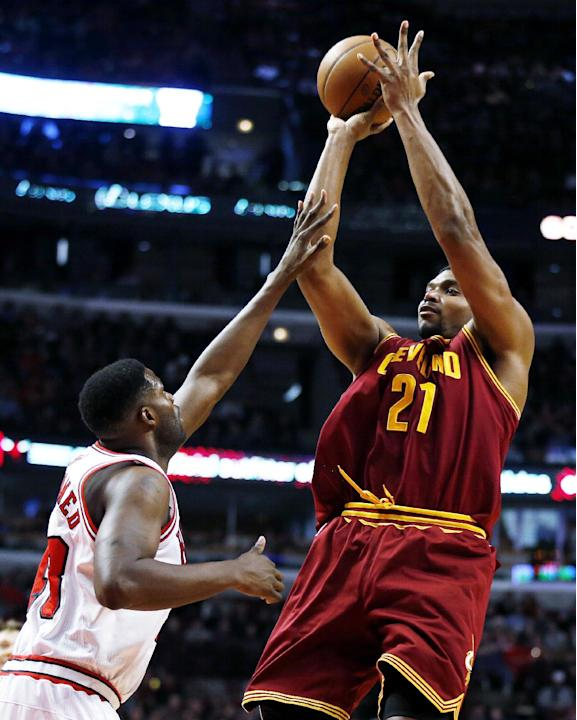 FILE - In this Dec. 21, 2013, file photo, Cleveland Cavaliers' Andrew Bynum (21) shoots over Chicago Bulls center Nazr Mohammed (48) during the first half of an NBA basketball game in Chicago. Mor