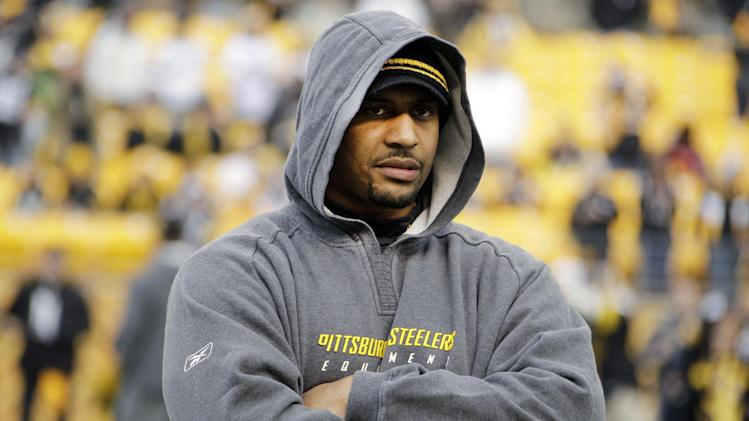 FILE - In this Dec. 24, 2011, file photo, Pittsburgh Steelers linebacker LaMarr Woodley watches warm ups before an NFL football game against the St. Louis Rams in Pittsburgh. In recent interviews with 40 players _ 13 rookies, 17 active veterans and 10 former NFL players _ The Associated Press heard growing worry about the physical and emotional toll professional football takes. The 43-year old former NFL linebacker Junior Seau's suicide at his oceanfront home on May 2, 2012, resonated across the age groups, with more than half of each saying that particular event pushed them to ponder their future in the sport or the difficulties of adjusting to a new daily life after leaving the league. (AP Photo/Gene J. Puskar, File)