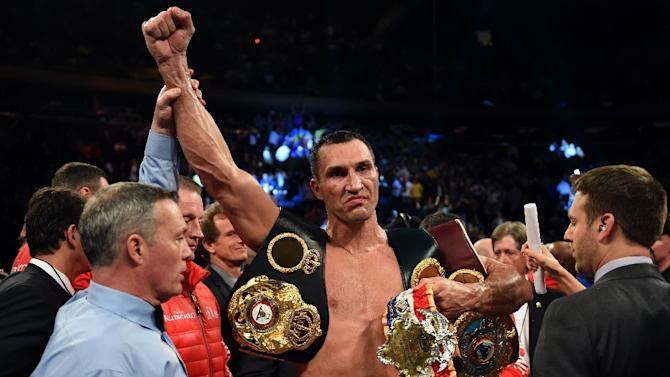 Wladimir Klitschko of Ukraine celebrates his win over Bryant Jennings of the US, after their World Heavyweight Championship boxing bout, at Madison Square Garden in New York, on April 25, 2015