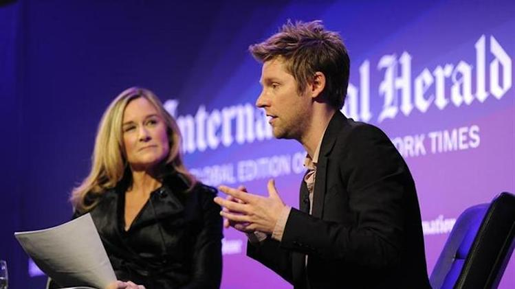 Burberry CEO Angela Ahrendts and Chief Creative Officer Christopher Bailey lead a discussion at the IHT Heritage Luxury conference in London November 9, 2010. REUTERS/Paul Hackett/Files
