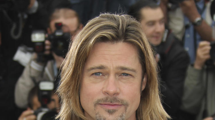 Actor Brad Pitt poses during a photo call for Killing Them Softly at the 65th international film festival, in Cannes, southern France, Tuesday, May 22, 2012. (AP Photo/Joel Ryan)