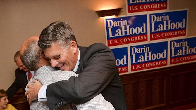 Darin LaHood, right, embraces a supporter at his victory party after he won the GOP nod in the primary to replace former U.S. Rep. Aaron Schock on Tuesday, July 7, 2105, in Peoria, Ill. LaHood heads into the Sept. 10 special general election. (Ron Johnson/Journal Star via AP)