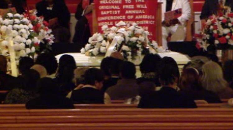 Funeral held for woman fighting for husband's freedom