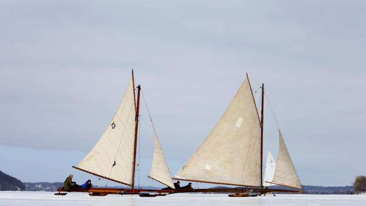 Antique ice sailboats from the Hudson River Ice Yacht Club's sail along side another on the frozen upper Hudson River near, Astor Point in Barrytown, New York