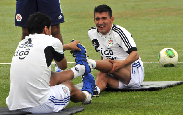 Paraguay's national team players Benitez and Mino attend a training session in Ypane